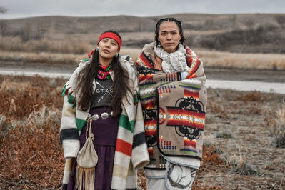 Ryan Vizzions, 'Two Dine women hold strong in sovereignty, only speaking their ancestral language at Turtle Island, Thanksgiving, 2016'