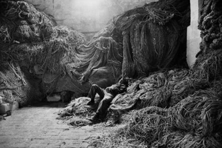 Sebastião Salgado, 'A tuna fisherman asleep on a net, Trapani, Sicily, Italy', 1991