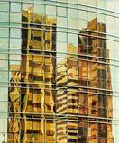 Reflections on a Yellow Glass Facade, Abu Dhabi
