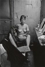 Stripper with bare breasts sitting in her dressing room, Atlantic City, N.J.