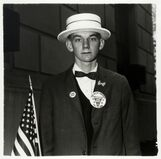Boy with a straw hat waiting to march in a pro-war parade, New York City