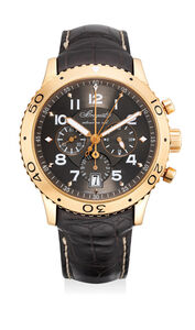 Breguet, 'A fine and attractive pink gold flyback chronograph wristwatch with 24 hours indication, date, guarantee and box', Circa 2007