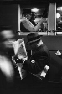 Louis Stettner, 'Commuters Reading Newspaper', 1958