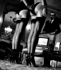 Two pairs of legs in bluch stockings, Paris