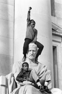 Stephen Shames, 'Boy gives raised fist salute on a statue in front of the New Haven County Courthouse during a protest against the Bobby Seale and Ericka Huggins trial, New Haven, Connecticut', 1970