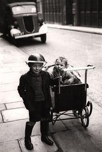 George Rodger, 'Boy in steel hat, East End, London, UK', 1940