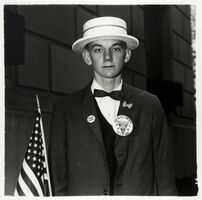 Diane Arbus, 'Boy with a straw hat waiting to march in a pro-war parade, New York City', 1967
