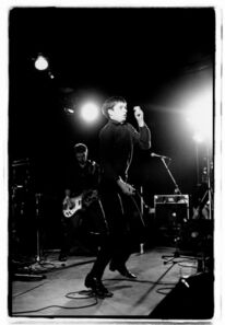 Kevin Cummins, '9. Peter Hook and Ian Curtis, Joy Division. Fac 15: Zoo meets Factory Half Way. Leigh Festival, Lancashire 27 August 1979 ', 2006