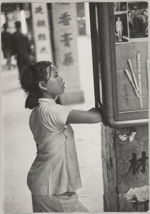 Werner Bischof, 'Looking at photos of the Hong Kong beauty queen display in a window', 1952