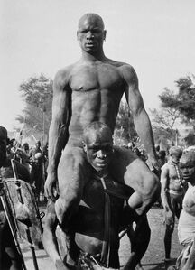 George Rodger, 'The victor of a Korongo Nuba wrestling match is carried shoulder high,  Southern Sudan', 1949