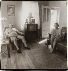 Retired man and his wife at home in a nudist camp one morning, N.J.