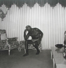 Charles Atlas seated in his Palm Beach House
