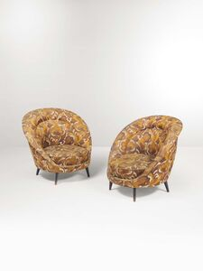 In the style of Ico Parisi, 'A pair of armchairs with a wooden structure and fabric upholstery', 1950 ca.