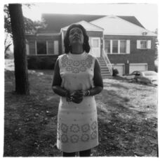 Mrs. Martin Luther King, Jr. on her front lawn, Atlanta, Ga.