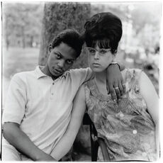 A young man and his pregnant wife in Washington Square Park, N.Y.C