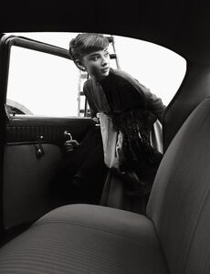 Bob Willoughby, 'Audrey Hepburn gets into the studio car after a long day at Paramount Studios, her first trip to Hollywood after filming 'Roman Holiday'', 1953