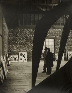 "Pedro E. Guerrero, 'Calder in Studio in Saché, France with ""Guillotine pour huit"" while preparing for Calder Retrospective at Guggenheim', 1964"