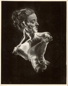 Gjon Mili, 'Double Exposure, Model with Swirling Evening Dress over Close up of Her Head with Faux Jewel Hair', 1946