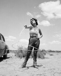 Frank Worth, 'Elisabeth Taylor with lasso on set of 'Giant'', 1955