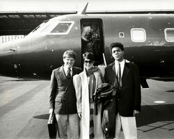 Andy Warhol, 'Andy Warhol, Photograph of Jean-Michel Basquiat, Richard Weisman and an Unidentified Woman by a Jet', 1983
