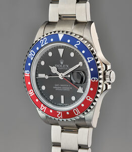 Rolex, 'A rare, new old stock, and exceptional stainless steel dual time wristwatch with rare dial type, bracelet, original guarantee and presentation box', Circa 2007
