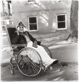 Diane Arbus, Masked Woman in a Wheelchair, PA