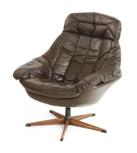 H W Klein, 'A brown leather lounge chair'