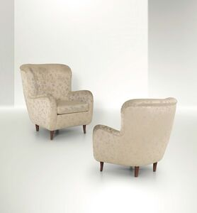 Attributed to Franco Albini, 'a pair of armchairs with a wooden structure and fabric upholstery', 1950 ca.