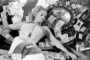 Terry O'Neill, 'Actress Ursula Andress posing on a roulette in the 1967 spy spoof 'Casino Royale' in which she plays Vesper Lynd.', 1967