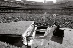 Terry O'Neill, 'English singer songwriter Elton John performing at Dodger Stadium in Los Angeles, October 1975', 1975