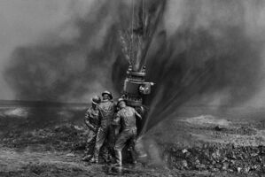 Sebastião Salgado, 'Workers Struggle to Remove Bolts, Oil Wells, Kuwait', 1991