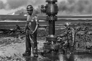 "Sebastião Salgado, 'Workers install the new wellhead to enable the injection of a chemical mud to ""kill the old well."", Oil wells, Greater Burhan, Kuwait', 1991"