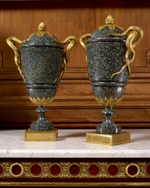 """A pair of Louis XVI period """" green porphyry """" vases mounted with entwined snake handles attributed to Pierre Gouthière"""
