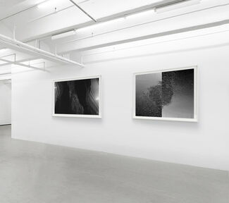 Two artists offering their world views in monochromatic schemes, installation view