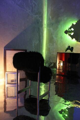 """LOOK BACK"" by Nanda Vigo on Mario Ceroli ed Ettore Sottsass Jr., installation view"