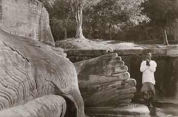 Man Praying at the Foot of Buddha, Sri Lanka