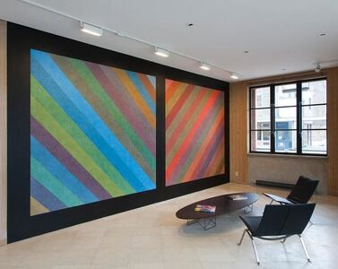 Sol LeWitt, 'Wall Drawing #701: The wall is bordered and divided vertically into two equal parts by 12-inch (30 cm) bands. Within each part, diagonal left or right bands with color ink washes superimposed', First drawn by: Manfredo de Souzanetto, Jo Watanabe; First installation: Museu Nacional de Belas Artes, Rio de Janeiro; June 1992