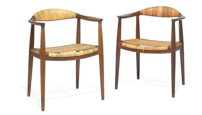 Hans Jørgensen Wegner, 'The Chair. A pair of dark patinated, solid oak armchairs. Seat and back with woven cane.'