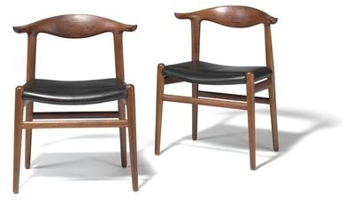 Hans Jørgensen Wegner, 'Cowhorn Chair. A pair of solid walnut chairs, back with rosewood inlays. Seats upholstered with black leather.'