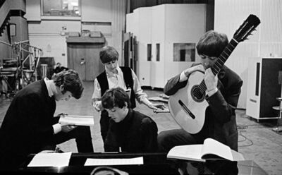 David Hurn, 'The Beatles in EMI Studios, later renamed Abbey Road Studios, where many of their most famous records were made, examining the script of the film 'A Hard Days Night'. London, England', 1964