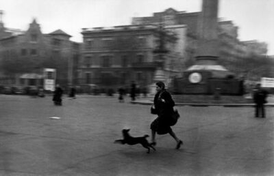 Robert Capa, 'Running for shelter during the air raid alarm. Barcelona.', 1939