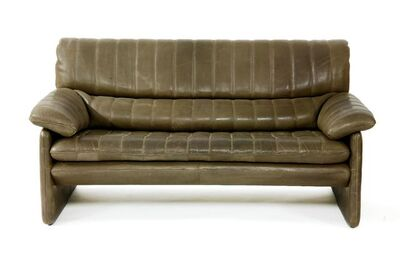 De Sede, 'A two-seater brown leather settee'