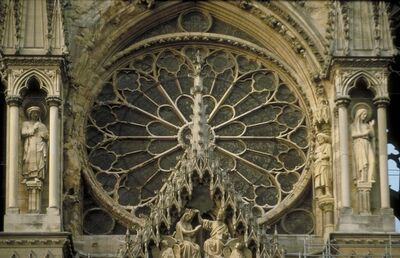 'Reims Cathedral: exterior, West facade, detail of rose window and gable over central portal (Coronation of the Virgin)', ca. 1211-1290