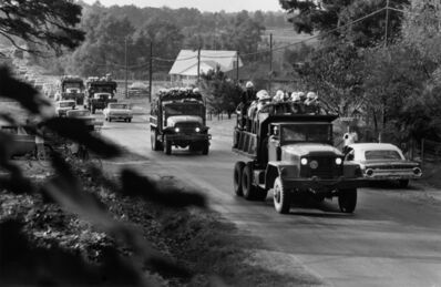 Charles Moore, 'U.S. marshals, helmeted and armed, roll into Oxford in army trucks', 1962