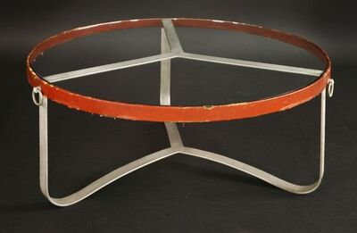Jacques Adnet, 'A steel and leather mounted circular coffee table'