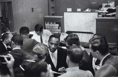 Bruce Davidson, 'Martin Luther King Jr. Talks to the Press in Trailway Station', 1961