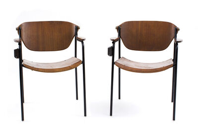 In the style of Osvaldo Borsani, 'Pair of chairs with tilting back and attached ashtray'