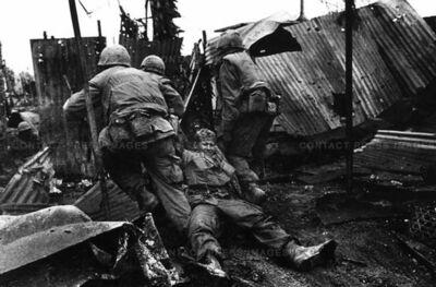 Don McCullin, 'U.S. Marines drag a wounded comrade, Têt offensive, Battle of Hué', 1968