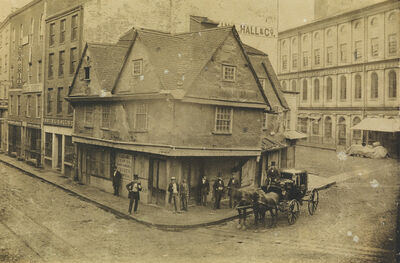 Attributed to John A. Whipple, 'The Old Feather Store on the corner of North Street and Dock Square, near Faneuil Hall', Circa 1855