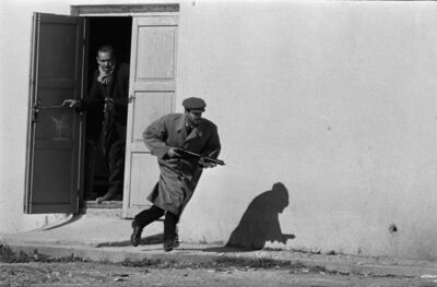 Don McCullin, 'Turkish defender leaving the side entrance of a cinema, Limassol, Cyprus', 1964